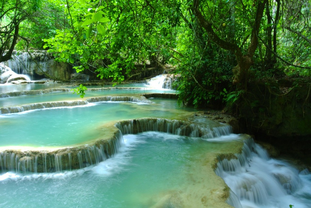 Kuang Si Falls lush tropical vegetation and limestone pools make it one of the most heavenly places on earth to meditate.