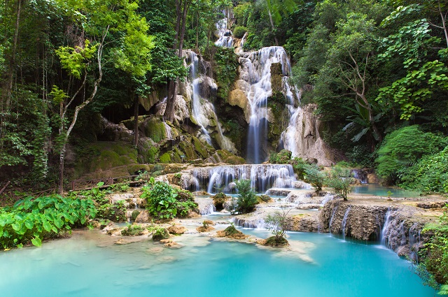 Kuang Si Waterfalls, beautiful cascade of blue waterfalls near Luang Prabang town in Laos.
